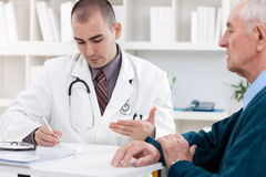 Doctor talking to senior patient Stock Photo
