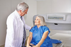 Doctor talking to senior patient in radiology Royalty Free Stock Photo