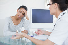 Doctor talking with upset looking patient Royalty Free Stock Photography