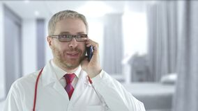 Doctor talks on his mobile phone. Shot on Red camera