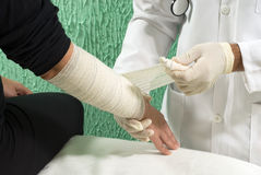 Doctor Tapes Arm - horizontal Royalty Free Stock Photo