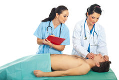 Doctor teach student resuscitation. Doctor woman teaching a student female to make resuscitation on patient male Stock Photos