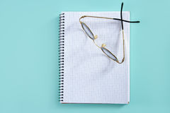 Doctor teacher glasses on blank spiral notebook Royalty Free Stock Images