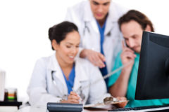 Doctor team making discussion over phone Royalty Free Stock Photos