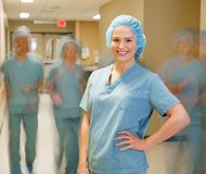 Doctor With Team Walking At Hospital Corridor Royalty Free Stock Photo