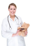Doctor with teddy Stock Images
