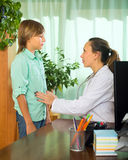 Doctor with teenager patient Royalty Free Stock Images
