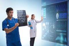 The doctor in telemedicine concept looking at x-ray image. Doctor in telemedicine concept looking at x-ray image royalty free stock photo