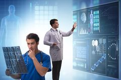 The doctor in telemedicine concept looking at x-ray image. Doctor in telemedicine concept looking at x-ray image stock images