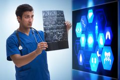 The doctor in telemedicine concept looking at x-ray image. Doctor in telemedicine concept looking at x-ray image stock image