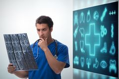 The doctor in telemedicine concept looking at x-ray image. Doctor in telemedicine concept looking at x-ray image royalty free stock image