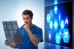 The doctor in telemedicine concept looking at x-ray image. Doctor in telemedicine concept looking at x-ray image royalty free stock images