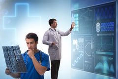 The doctor in telemedicine concept looking at x-ray image royalty free stock photography