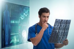 Doctor in telemedicine concept looking at x-ray image. The doctor in telemedicine concept looking at x-ray image stock images