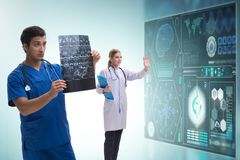 Doctor in telemedicine concept looking at x-ray image. The doctor in telemedicine concept looking at x-ray image stock photography
