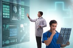 The doctor in telemedicine concept looking at x-ray image. Doctor in telemedicine concept looking at x-ray image stock photos