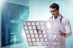 The doctor in telemedicine concept looking at x-ray image. Doctor in telemedicine concept looking at x-ray image stock photography