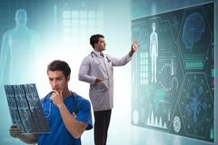 The doctor in telemedicine concept looking at x-ray image. Doctor in telemedicine concept looking at x-ray image stock photo