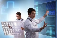 The doctor in telemedicine concept looking at x-ray image. Doctor in telemedicine concept looking at x-ray image royalty free stock photography