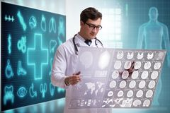 The doctor in telemedicine concept looking at x-ray image. Doctor in telemedicine concept looking at x-ray image royalty free stock photos
