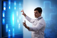 The doctor in telemedicine concept looking at screen royalty free stock images