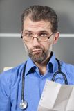 Doctor tells result of inspection Stock Image