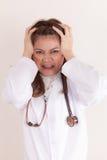Doctor tensionado imagen de archivo libre de regalías