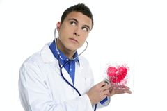 Doctor test a red heart health, young man Royalty Free Stock Photography
