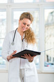 Doctor with test result in document or dossier Stock Photography