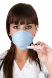 Doctor with thermometer and protective flu mask Stock Photo