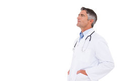 Doctor thinking with hands in pockets Stock Photos