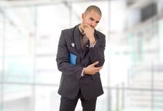 Doctor thinking with his notes, at the hospital stock images