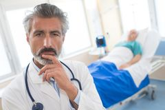 Doctor thinking about mistake he made. Doctor thinking about the mistake he made Stock Photos