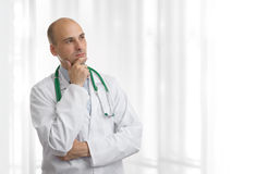 Doctor thinking Stock Photo