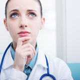 Doctor thinking Stock Images