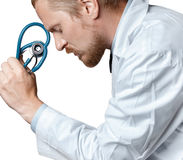 Doctor Thinking And Tired. Doctor Is Considering Diagnosis. Patient Care Concept Royalty Free Stock Photo