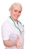 Doctor with thumb up. A female doctor on white background Stock Photos