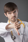 Doctor with thumbs down sign Royalty Free Stock Image