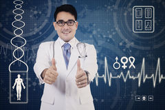 Doctor with thumbs up and futuristic screen Royalty Free Stock Photos