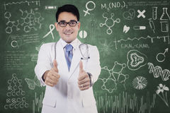 Doctor with thumbs up and scribble Royalty Free Stock Photos