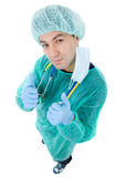 Doctor thumbs up. Young male doctor going thumbs up, isolated Stock Images