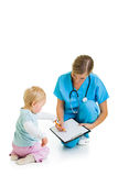 Doctor with toddler child Royalty Free Stock Photo