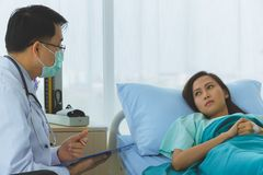 Doctor took the pulse of the female patient royalty free stock photography