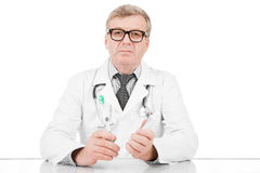 Doctor with tooth paste and tooth brush in hands stock photos