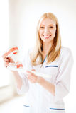Doctor with toothbrush and jaws in hospital Stock Photography