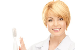 Doctor with toothbrush Stock Photo
