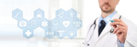 Doctor touch screen with a pen, medical symbols icons on backgro. Und health care concept Stock Image