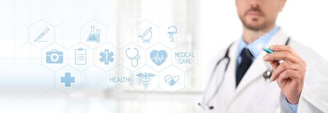 Doctor touch screen with a pen, medical symbols icons on backgro. Und health care concept Royalty Free Stock Photography
