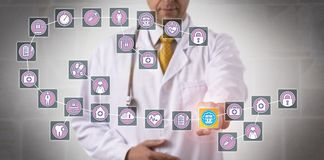 Doctor Touching Data Block In Medical Blockchain. Unrecognizable male physician is highlighting a data block record in a healthcare blockchain. Health care IT Stock Images