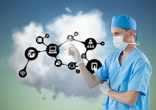 Doctor touching digitally generated icons against sky and clouds. Close-up of doctor touching digitally generated icons against sky and clouds royalty free stock images